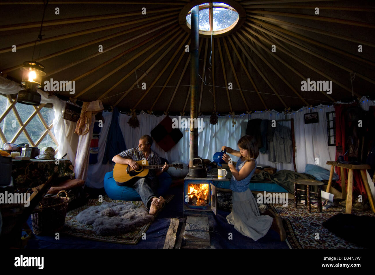 Father and daughter at home in their yurt in a field in Sussex, England. - Stock Image