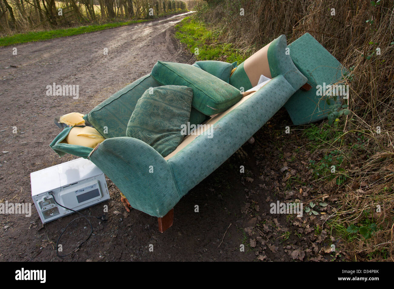 Microwave, Sofa And Chair, Furniture Dumped Fly Tipping On A Country Lane  At The Warren, Hay On Wye, Powys, Wales, UK