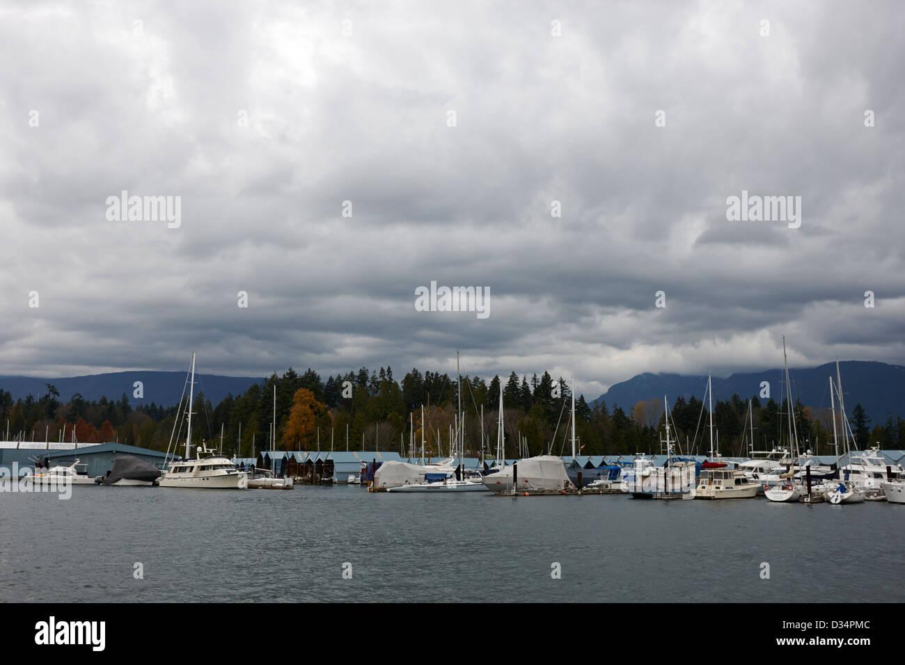 Royal Vancouver Yacht Club marina at Jericho Beach under cloudy overcast sky BC Canada - Stock Image