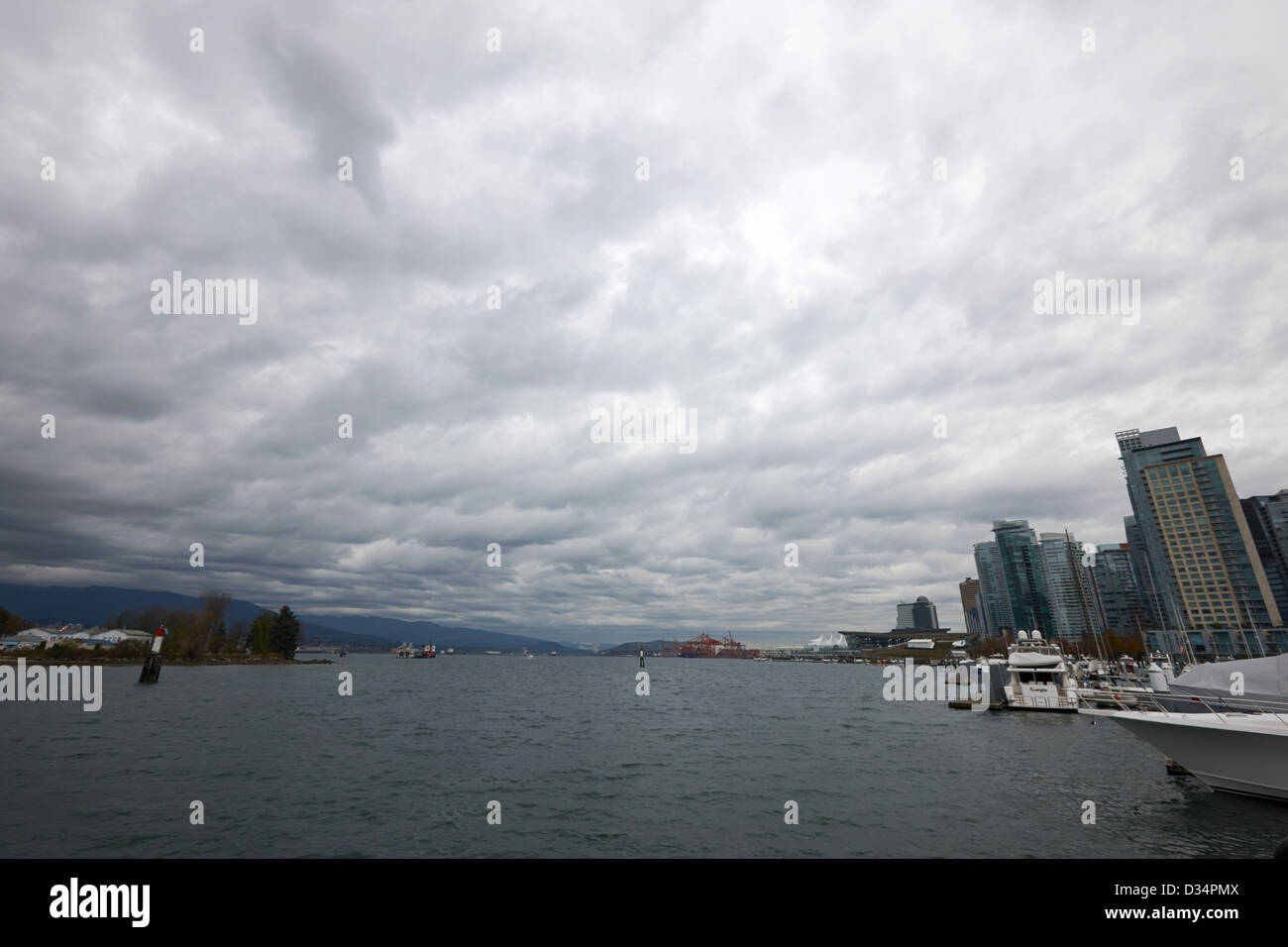 looking out from coal harbour into Vancouver Harbour on an overcast cloudy day BC Canada - Stock Image