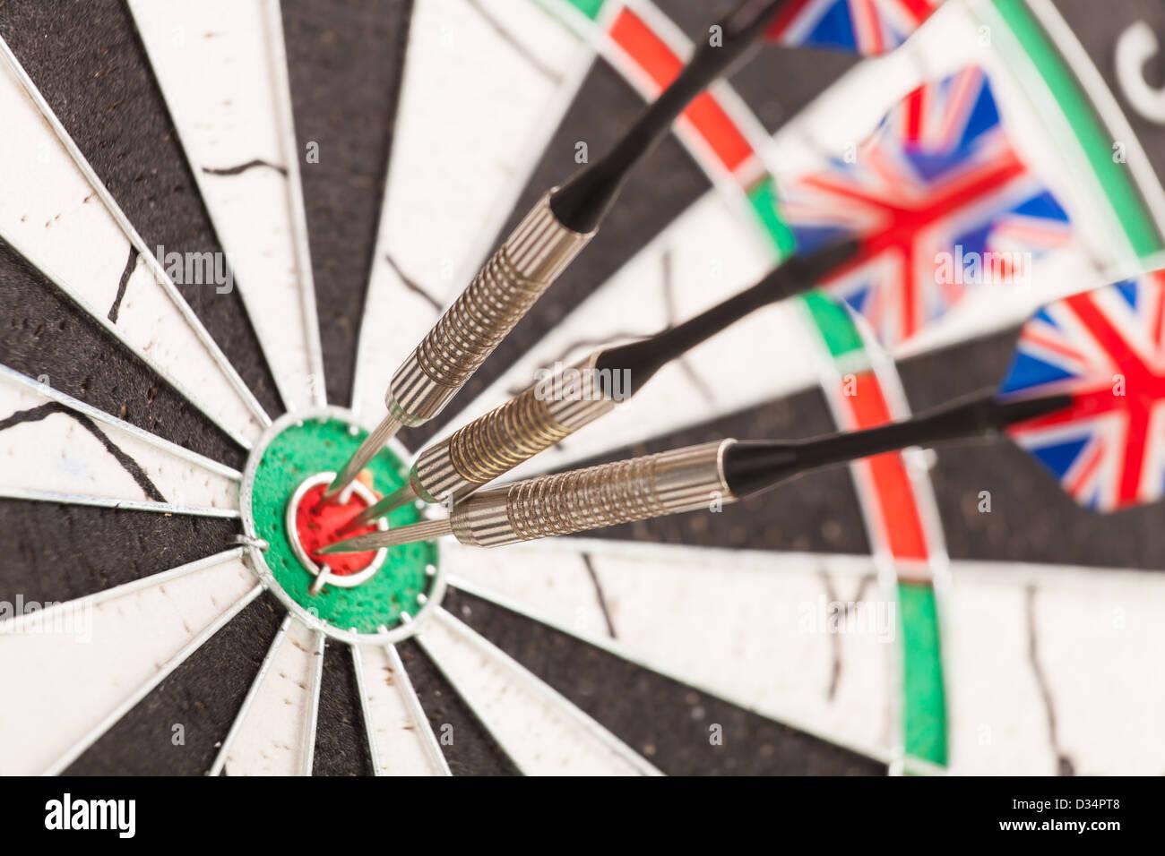 dart arrows dartboard full frame closeup - Stock Image