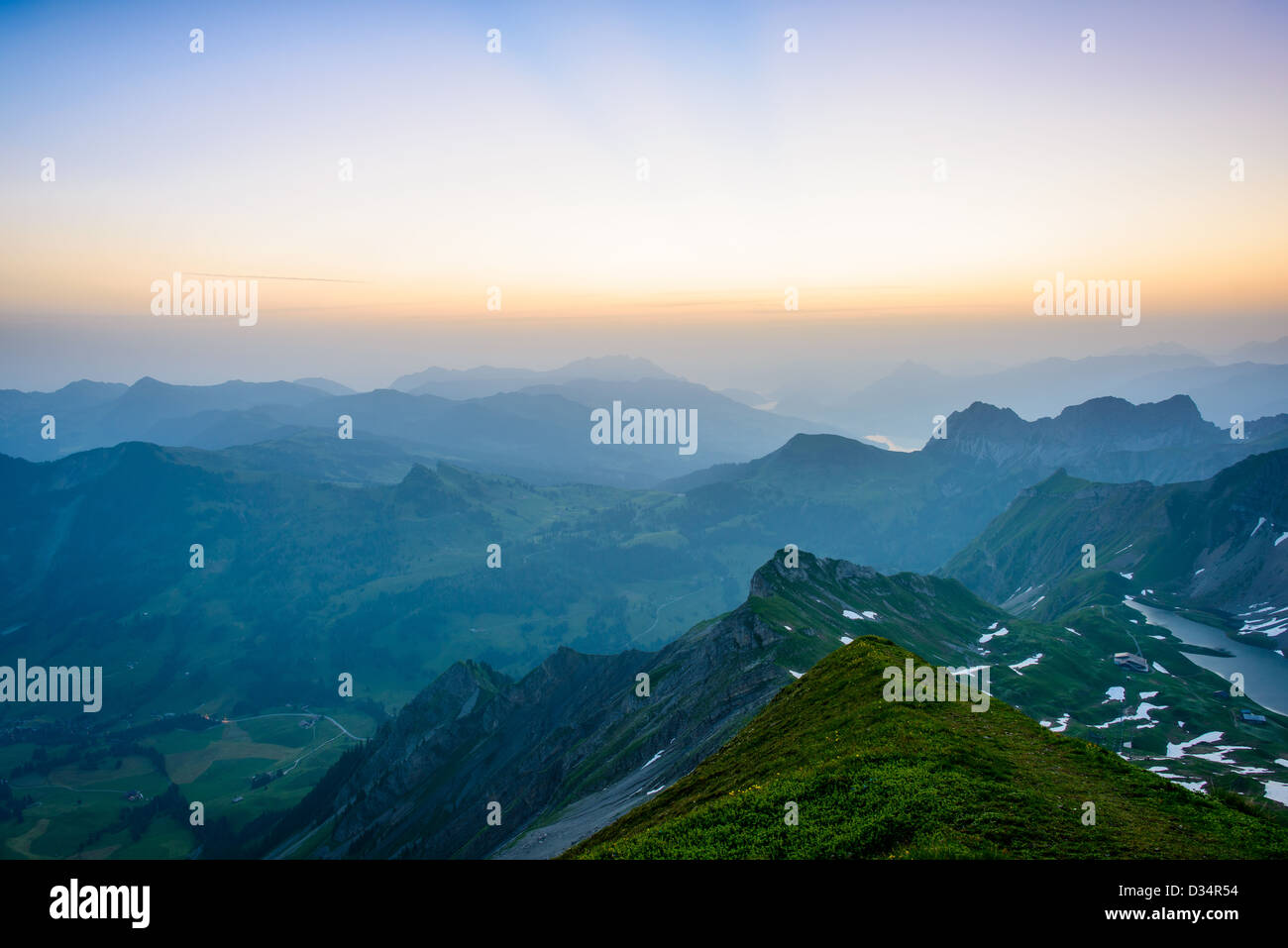 Sunrise mountain panorama from Brienzer Rothorn with purple sky, Switzerland. Stock Photo