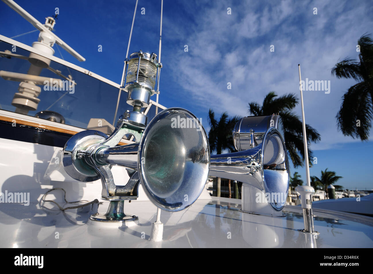 boat horn and light on a yacht with palm trees in background - Stock Image