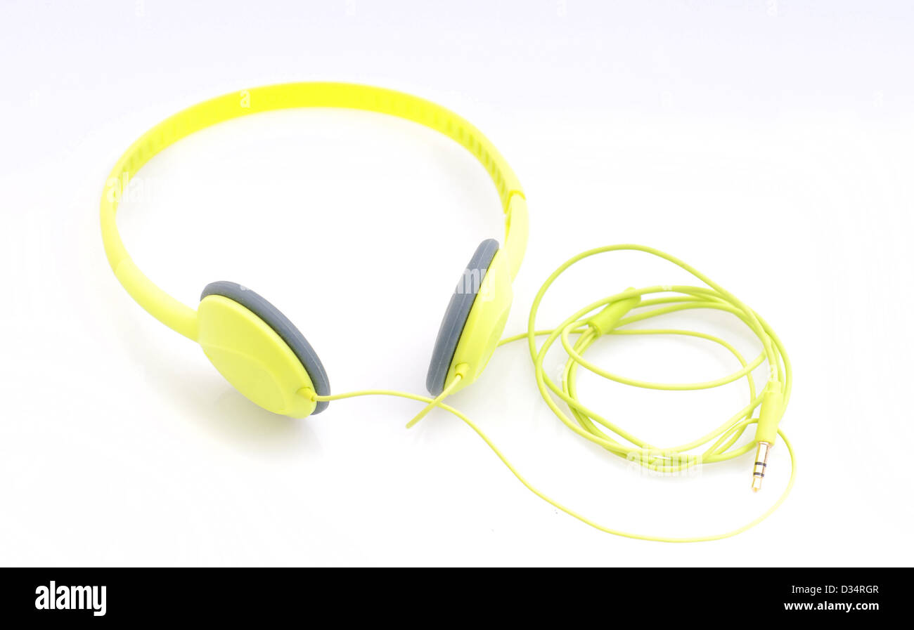 Bright yellow headphones for listing to music - Stock Image