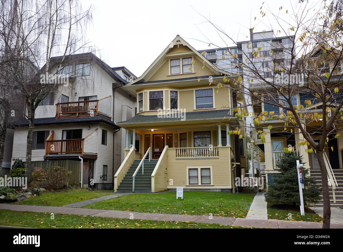 west end old wooden townhouses Vancouver BC Canada - Stock Image
