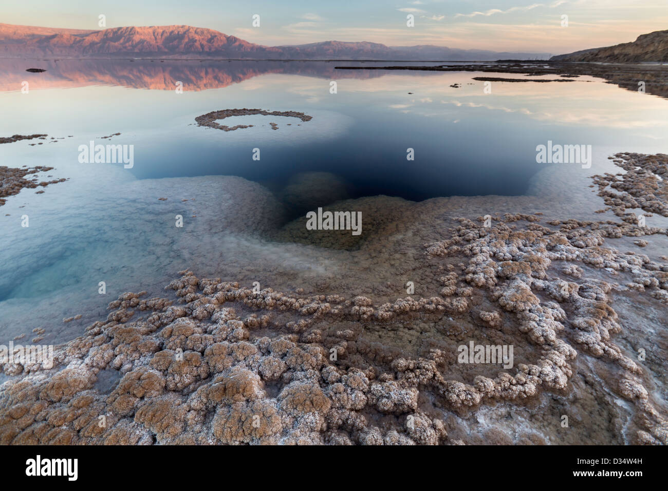 View of the Dead Sea coastline at sunset time Stock Photo