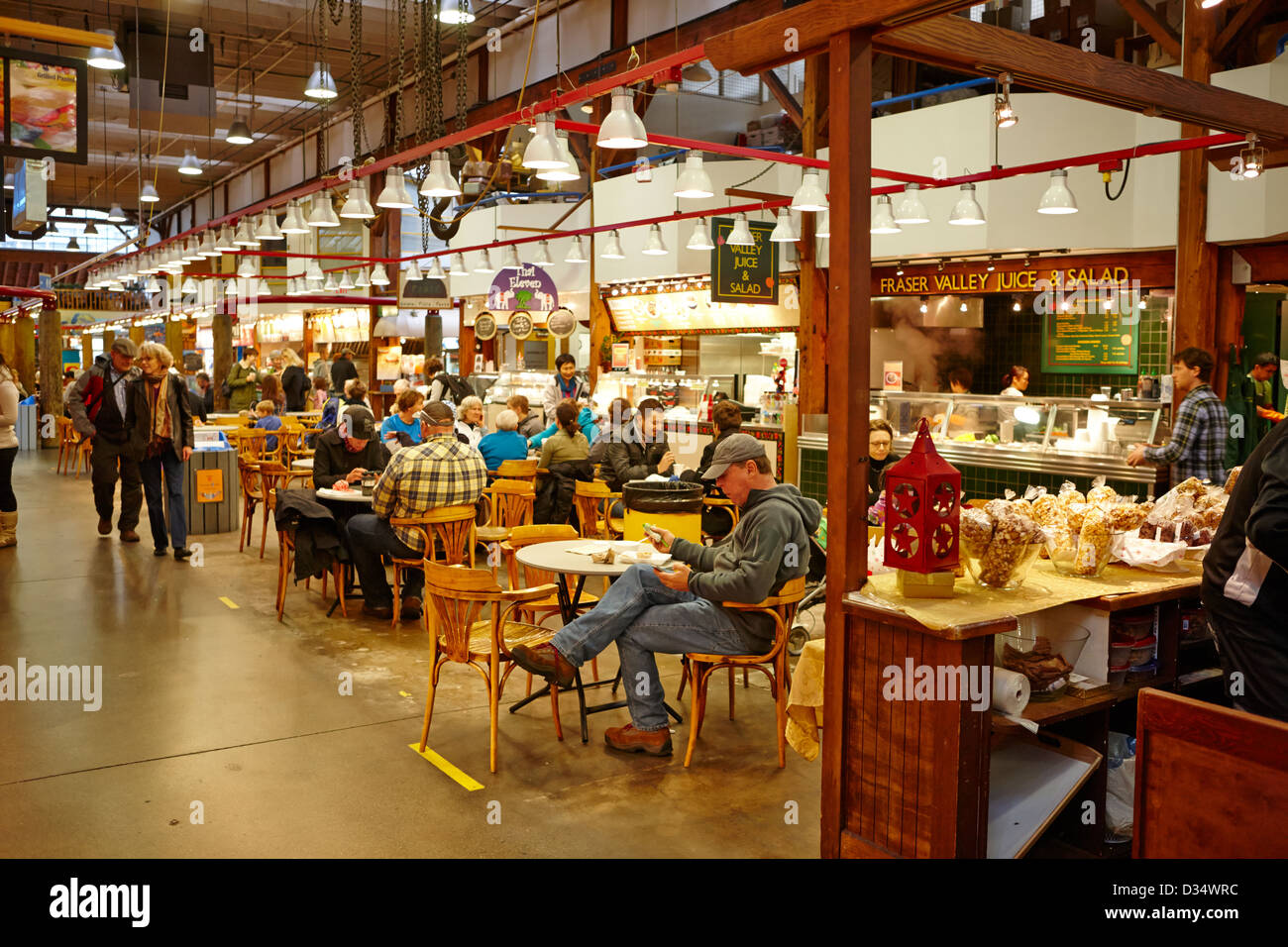 food court inside granville island public market Vancouver BC Canada - Stock Image