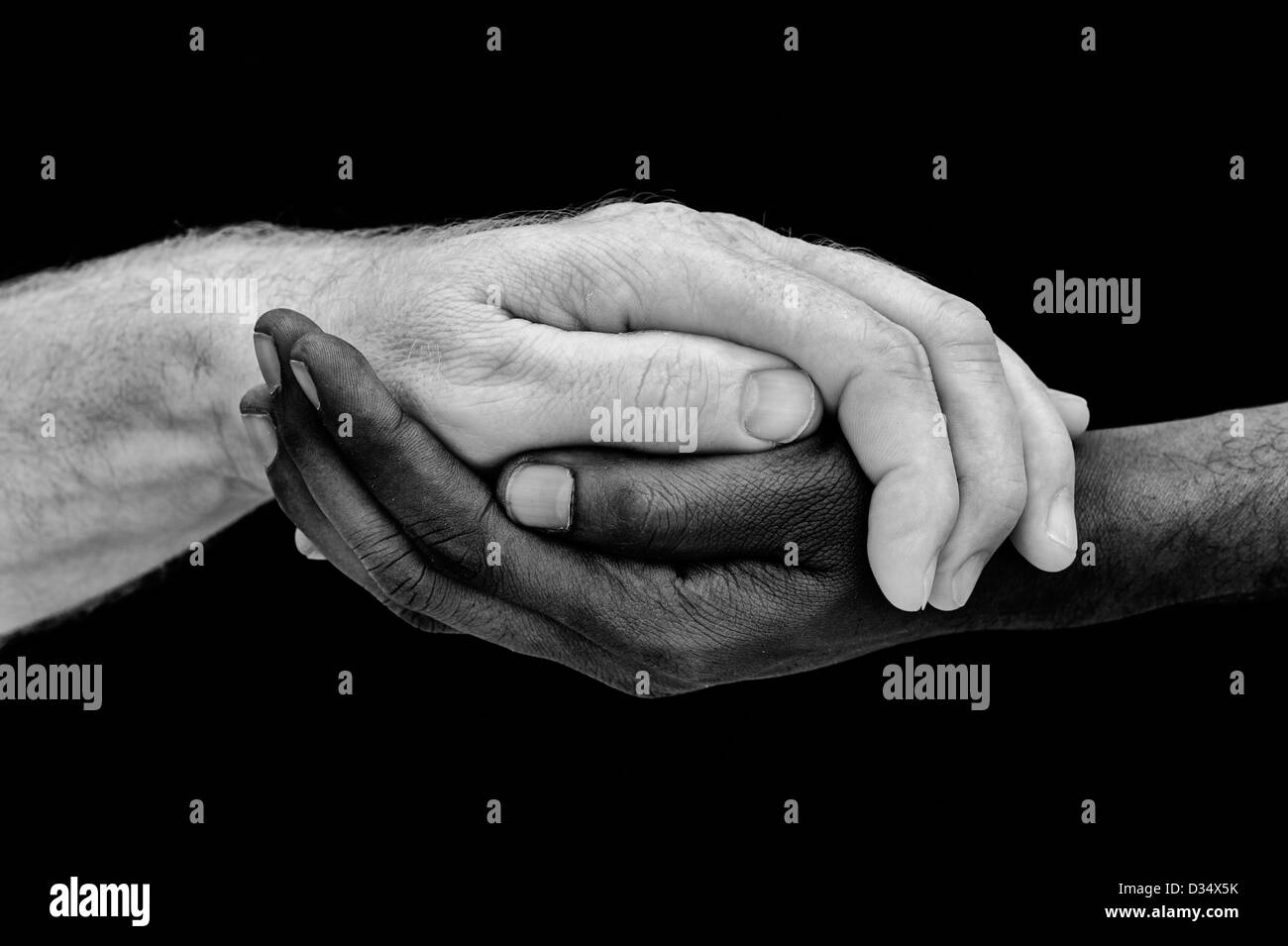 indian and englsih hands. Western and Eastern hands. Black and white. One humanity concept Stock Photo