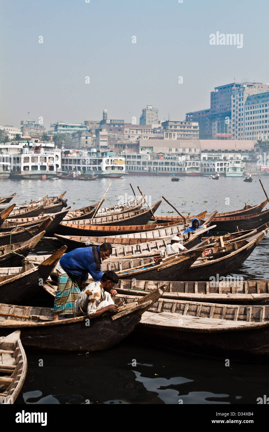 Sampan boats moored on the bank of the Buriganga river in Dhaka, Bangladesh. - Stock Image