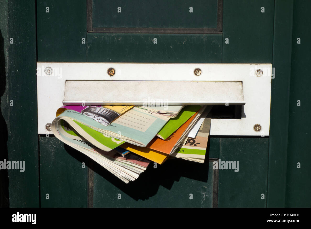 Mailbox filled with junk mail leaflets - Stock Image
