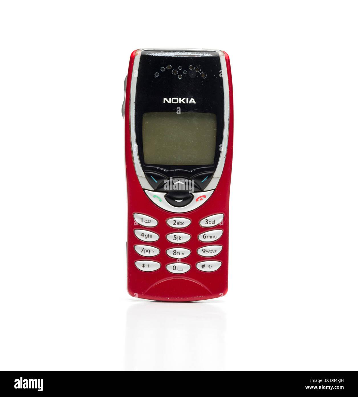 Old Nokia mobile phone isolated on white background - Stock Image