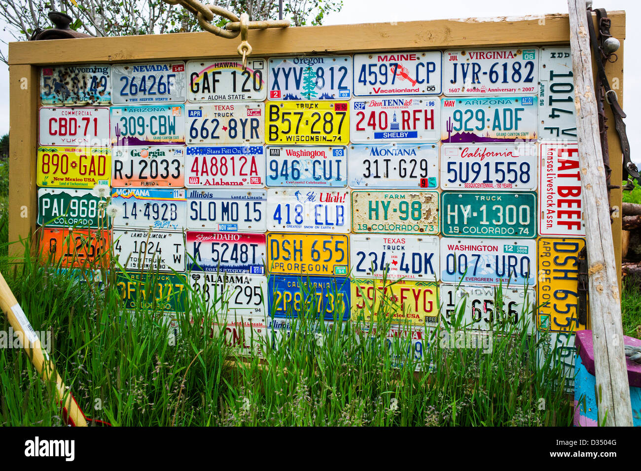Display of state auto license plates, Homer, Alaska, USA - Stock Image