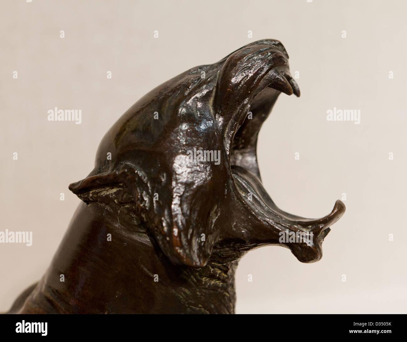 Yawning tiger sculpture - Stock Image