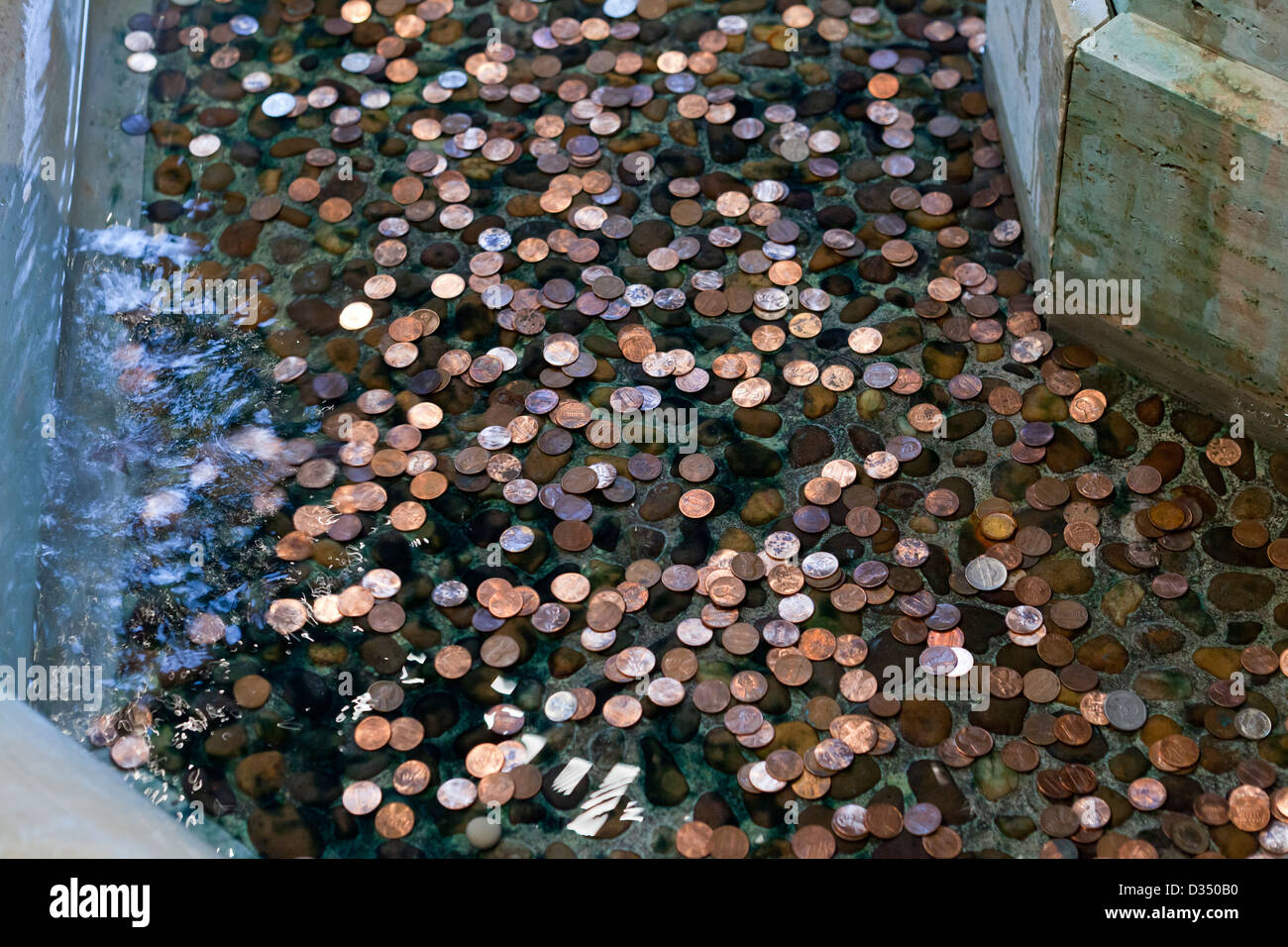 Coins in fountain - Stock Image