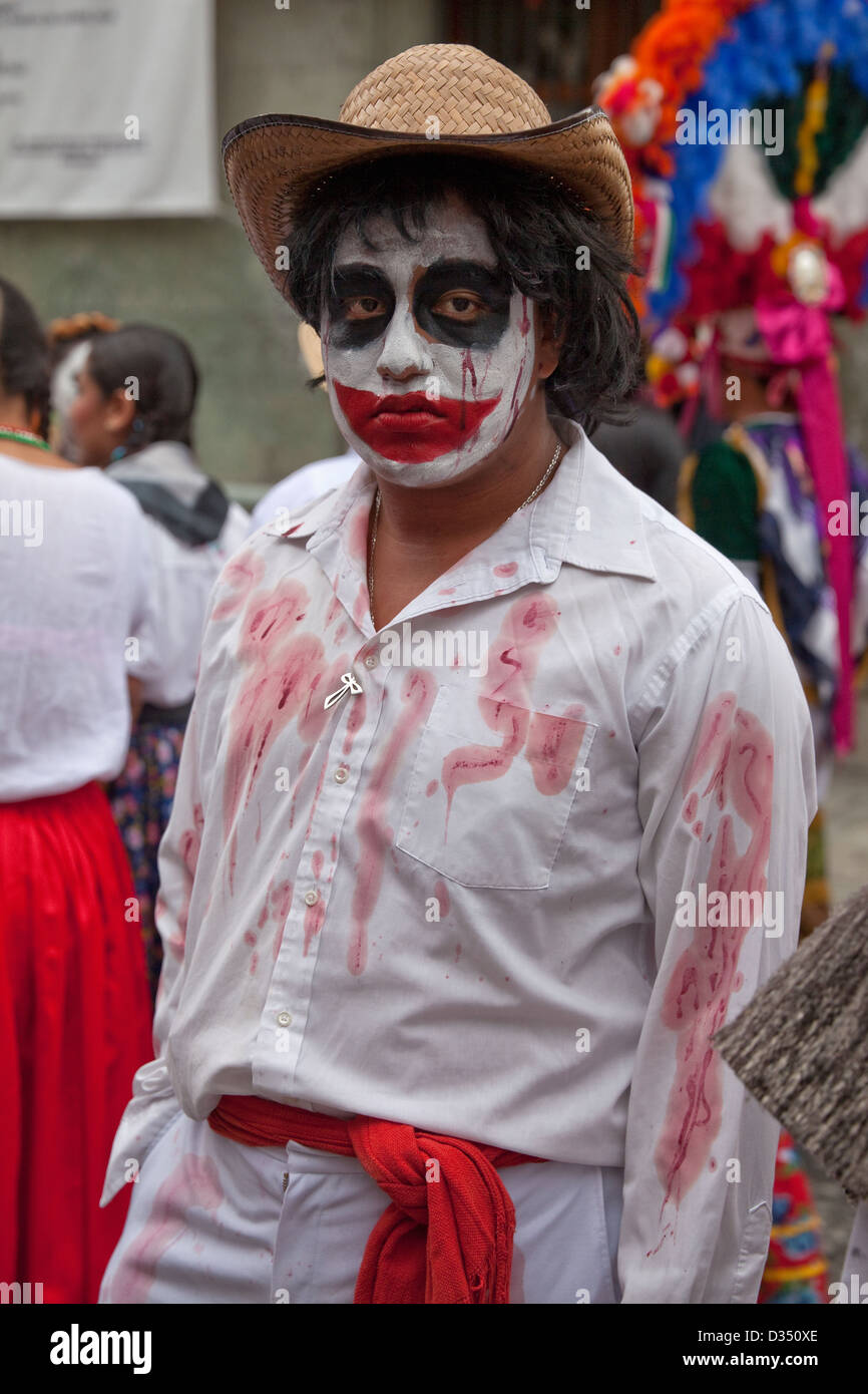 Day of the Dead festival participant in fake-blood-spattered costume in Oaxaca, Mexico. - Stock Image