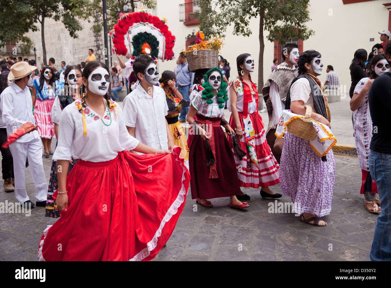fd4e7c49ab6 Day of the Dead parade with participants in traditional clothing and ...