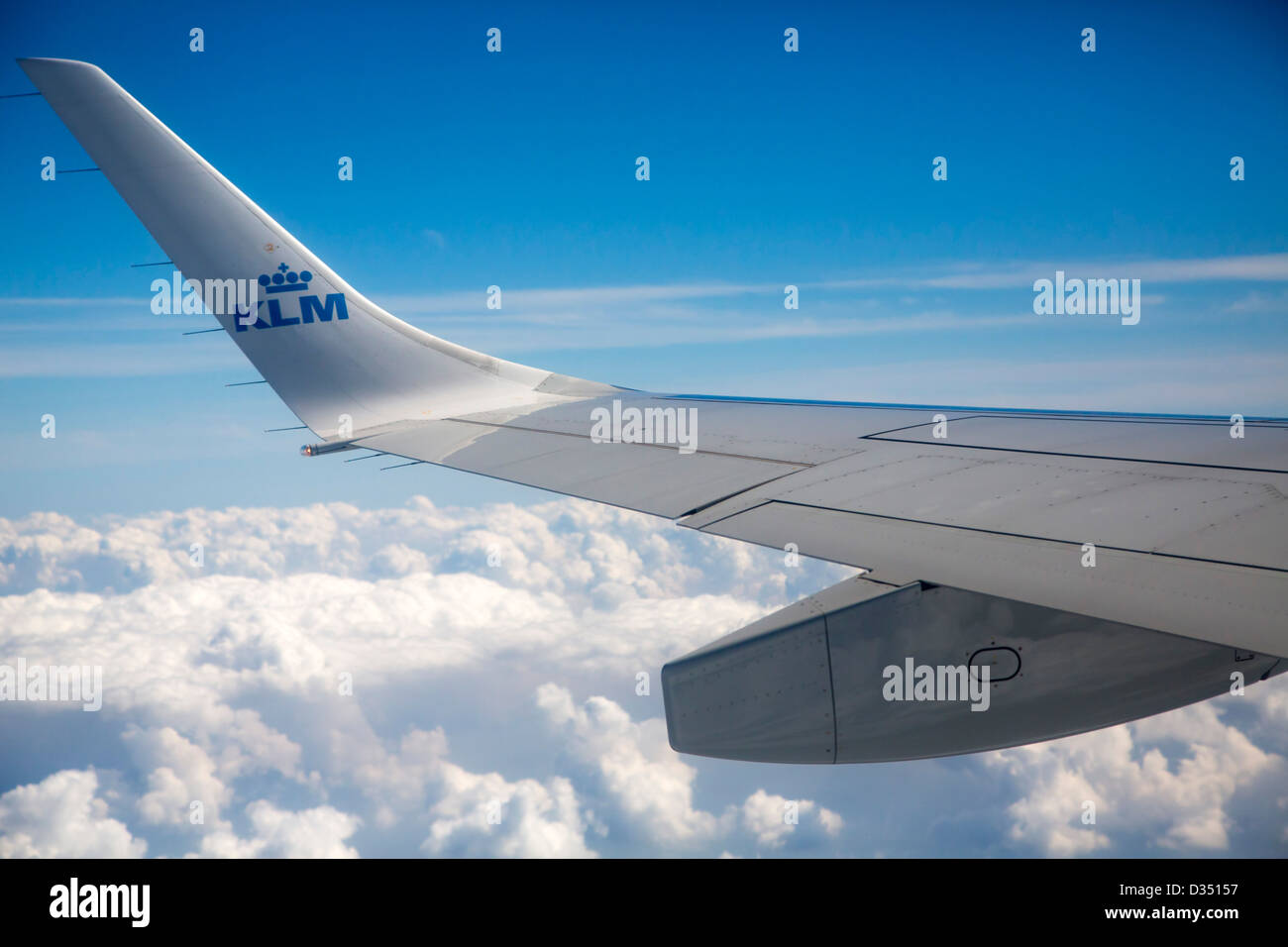 Window view of KLM jet flying over cloud Stock Photo