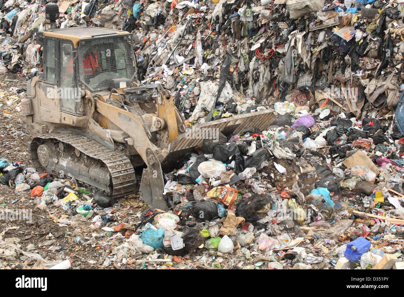 Bulldozer on landfill site, Dorset UK Febuary - Stock Image