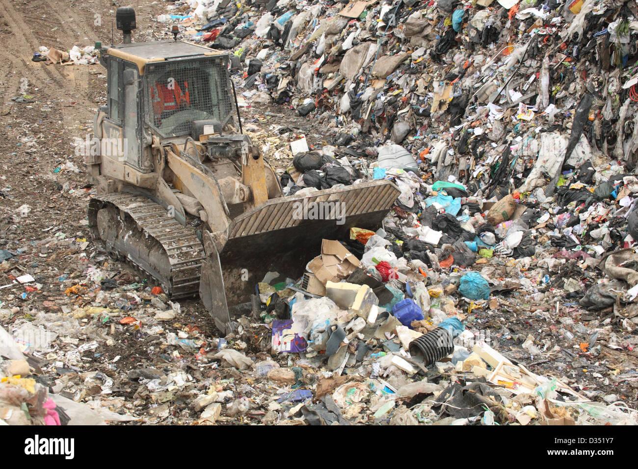 Bulldozer on landfill, Dorset UK Febuary - Stock Image
