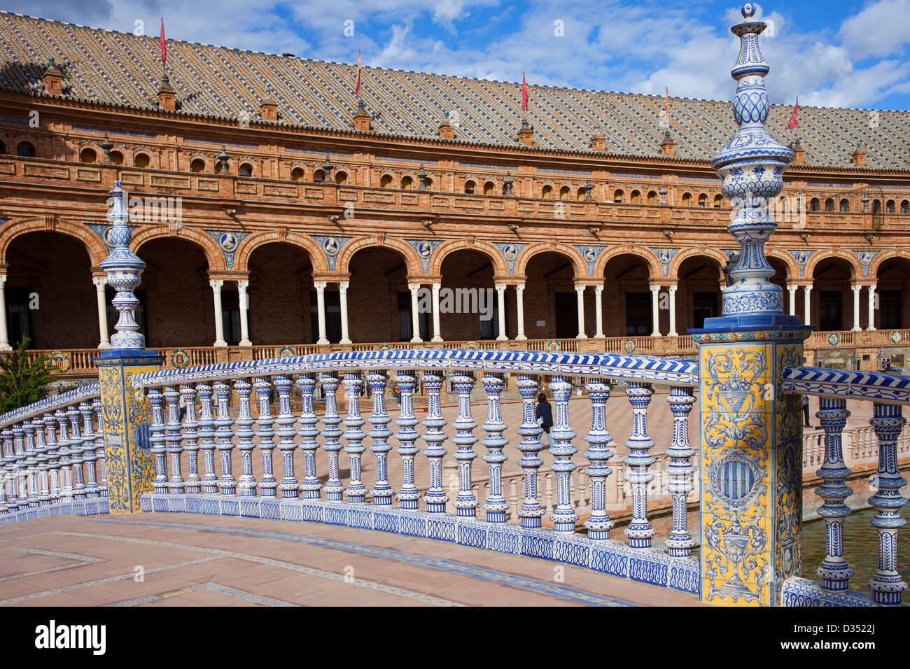 Bridge balustrade decorated with painted Azulejos tiles on Plaza De Espana in Seville, Spain. - Stock Image
