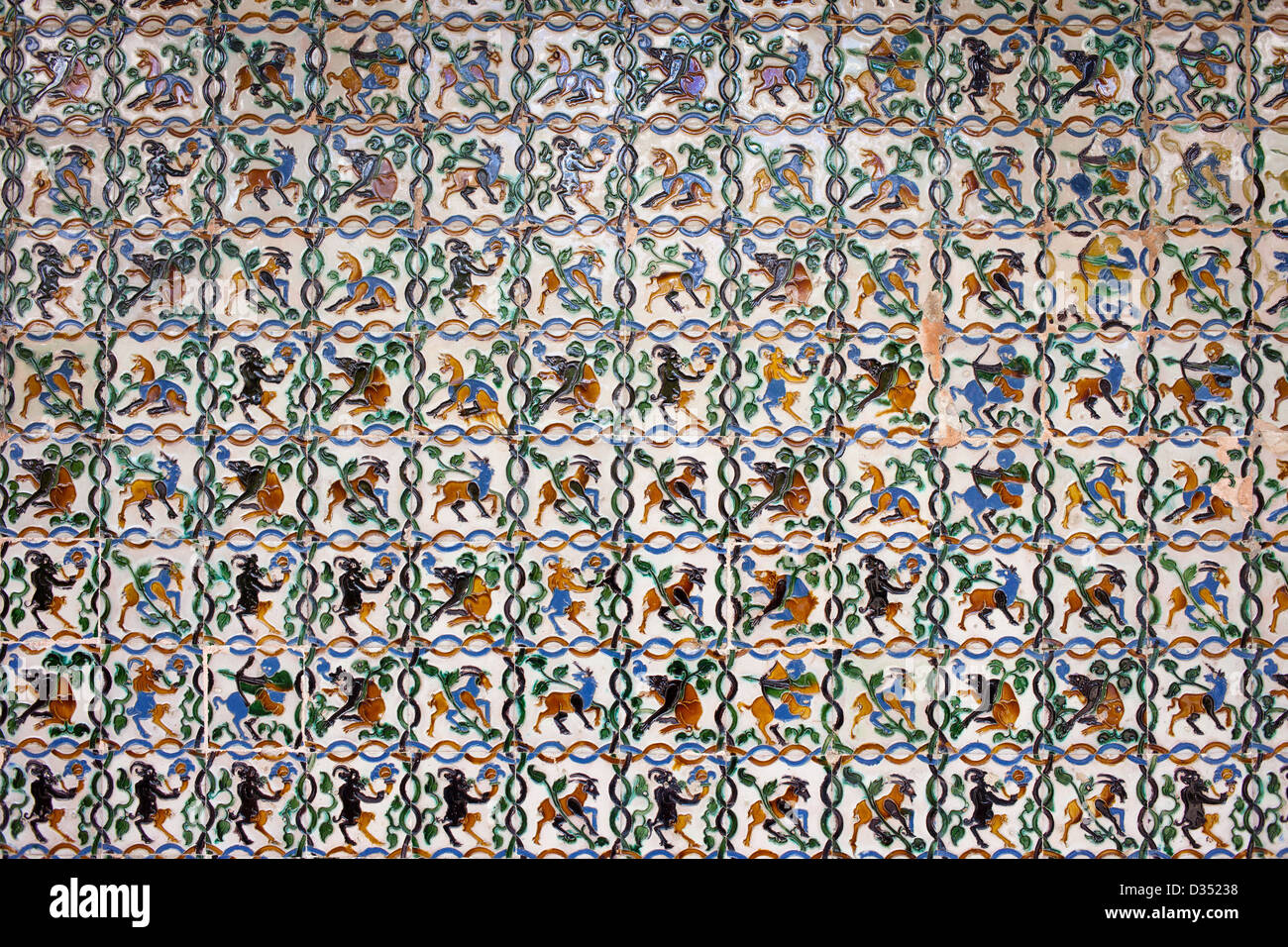 Historic tiled wall with satyrs, centaurs, goats and other mythical creatures, Real Alcazar, Seville, Spain, Andalusia - Stock Image