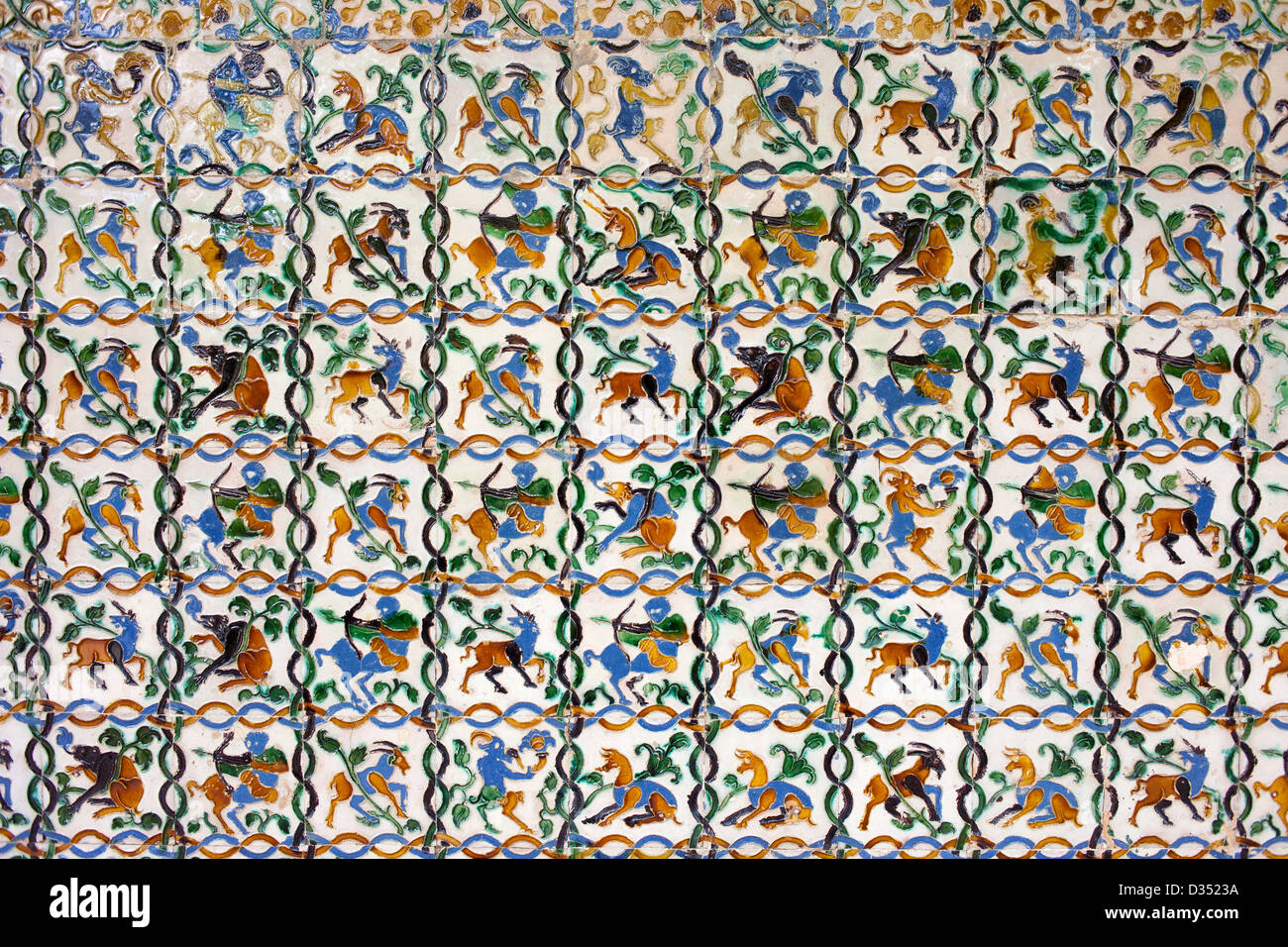 Historic tiled wall with many mythical creatures: satyrs, centaurs, unicorns in Real Alcazar, Seville, Spain, Andalusia - Stock Image