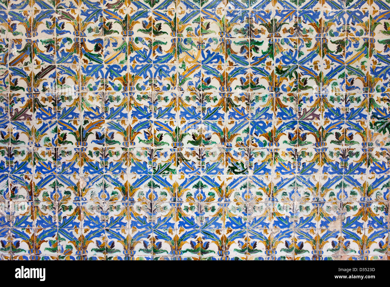 Old, historic Azulejos tiles in the Mudejar Style, Real Alcazar, Seville, Spain, Andalusia region. - Stock Image