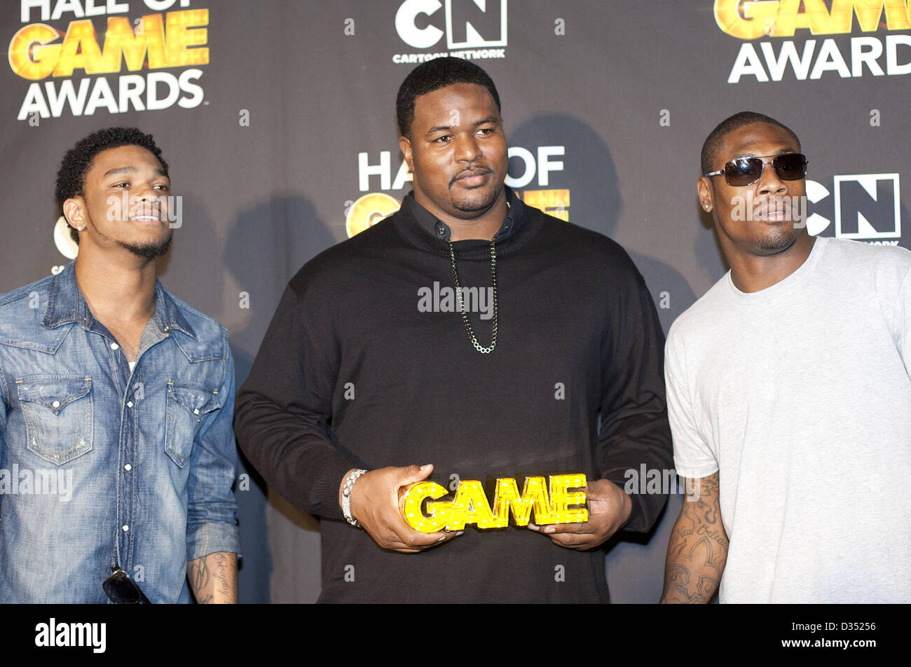 Santa Monica, California, U.S - Professional football players Jimmy Smith, Bryant McKinnie, and Jacoby Jones pose - Stock Image