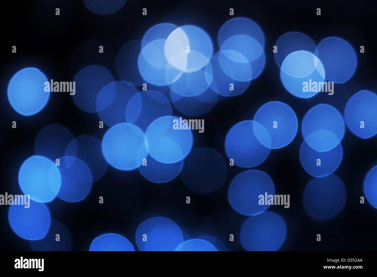 Unfocused blue lights holiday background - Stock Image