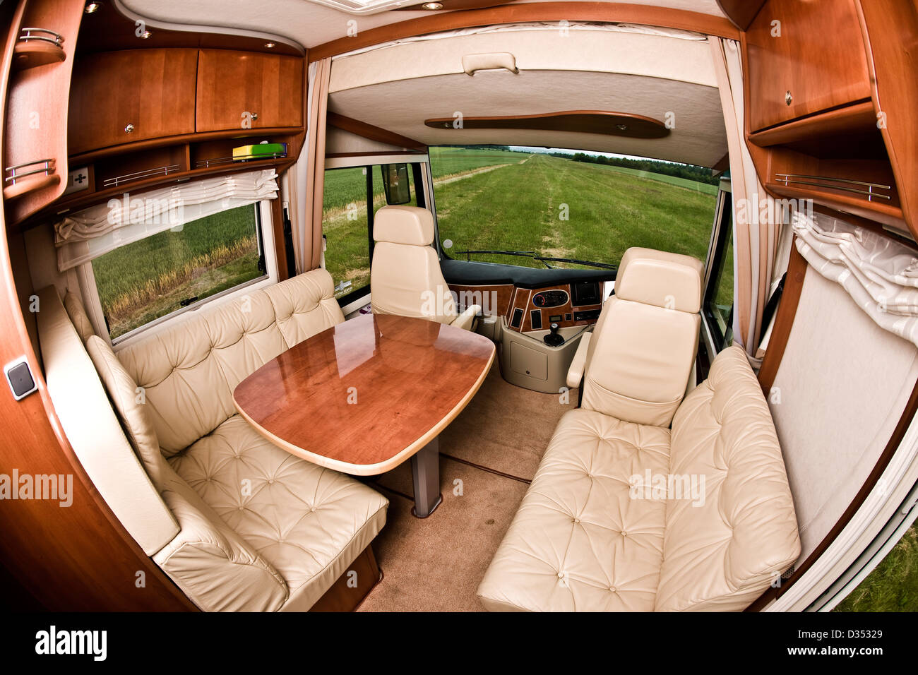 Seating Area And Table In Concorde Luxury Motorhome Interior