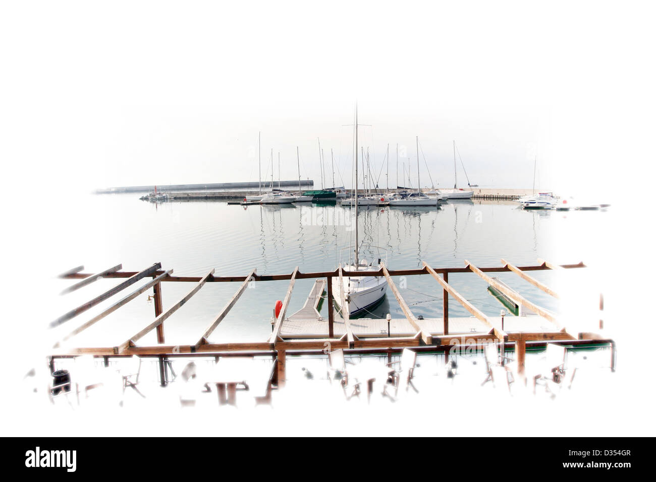 White sailing boats in port. - Stock Image