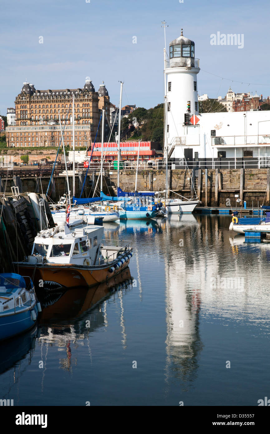 The harbour & lighthouse at Scarborough, North Yorkshire, England, U.K. - Stock Image