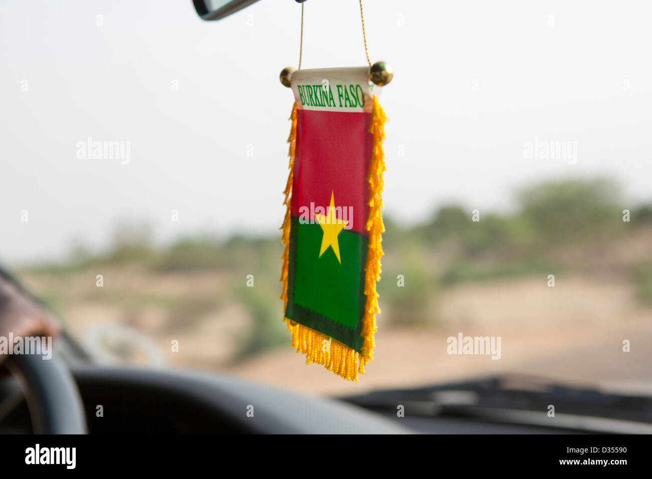Burkina Faso, May 2012: National flag car decoration. - Stock Image