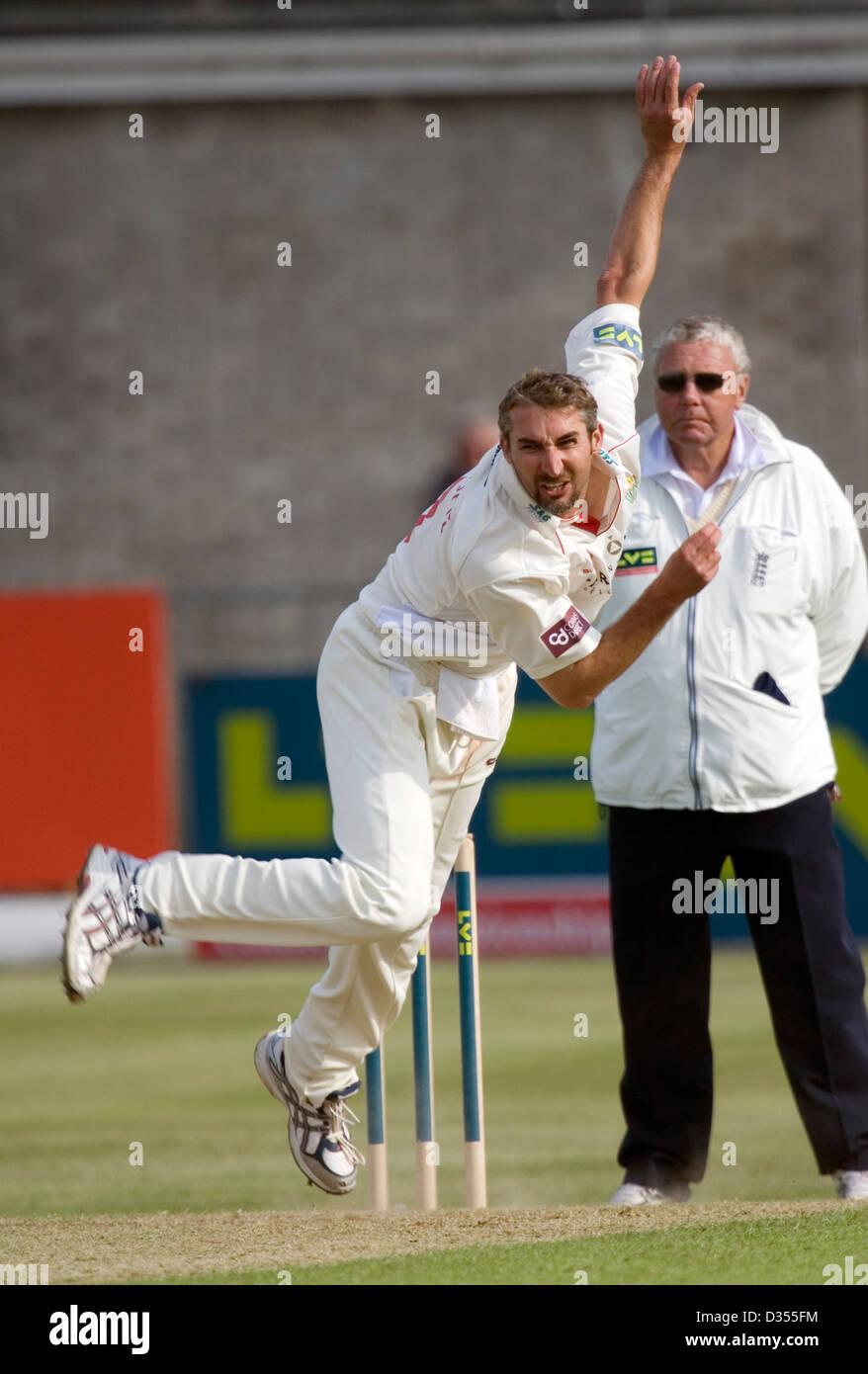21.05.08 Glamorgan v Northants at St. Helens Swansea Jason Gillespie bowls at David Sales. - Stock Image