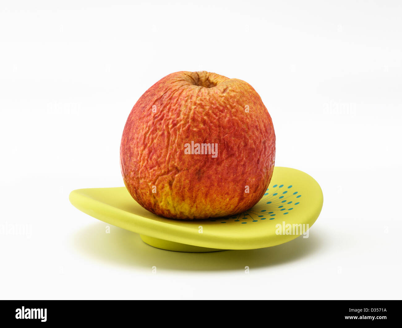 Close up of a wrinkly aged apple - Stock Image