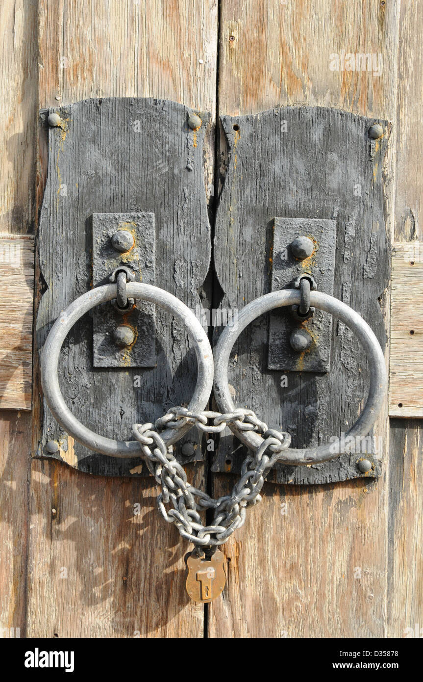 Lock And Chains On Rustic Old Wooden Door
