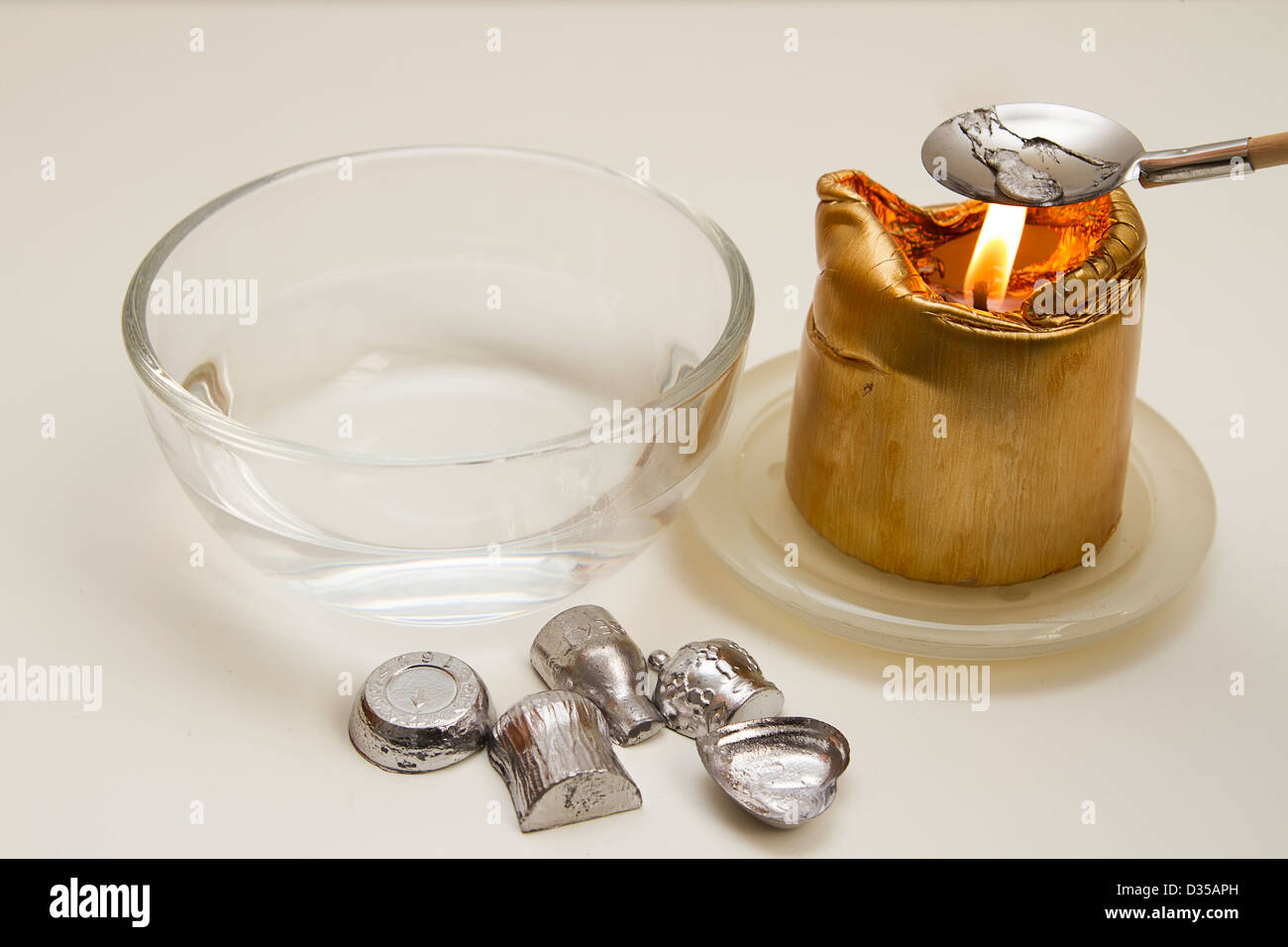 New year tradition melting lead - Stock Image