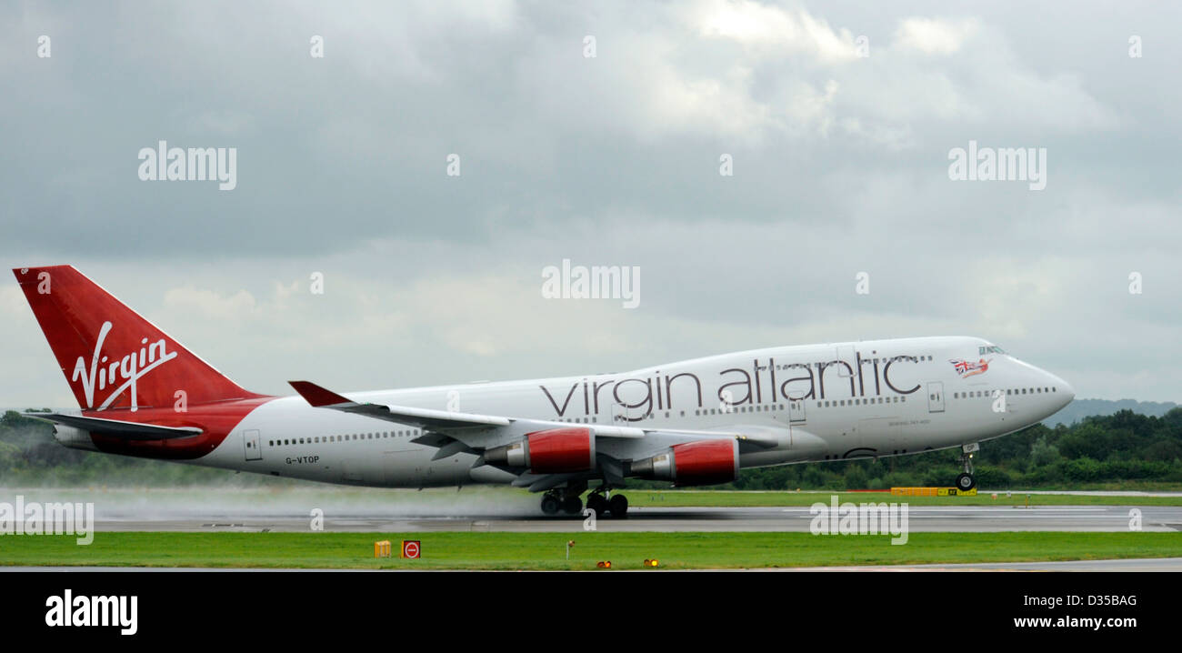 G-VTOP Boeing 747-4Q8 from Virgin Atlantic takes off on a wet runway at Manchester Airport - Stock Image