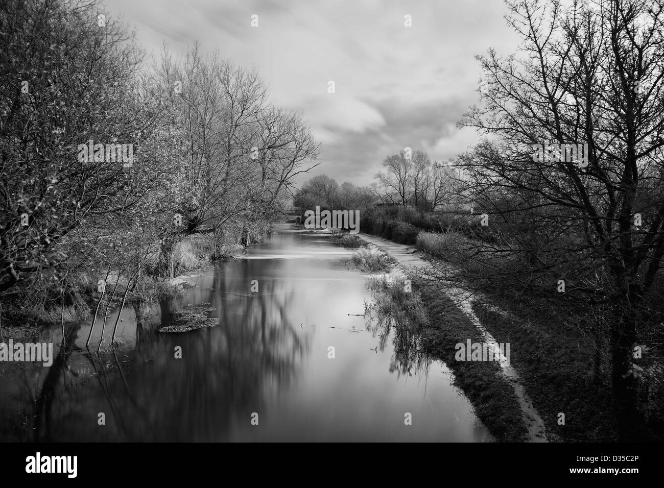 The Flooded Canal near the spine road at South Cerney in Gloucestershire . - Stock Image