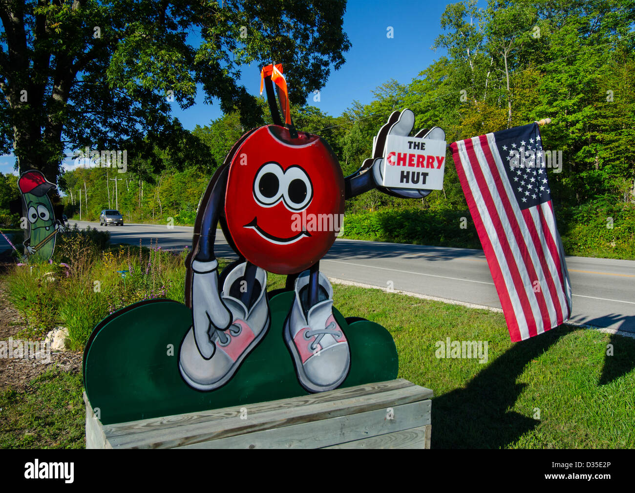 Sign for the Cherry Hut in the Door County town of Fish Creek, Wisconsin which features products made from Door - Stock Image