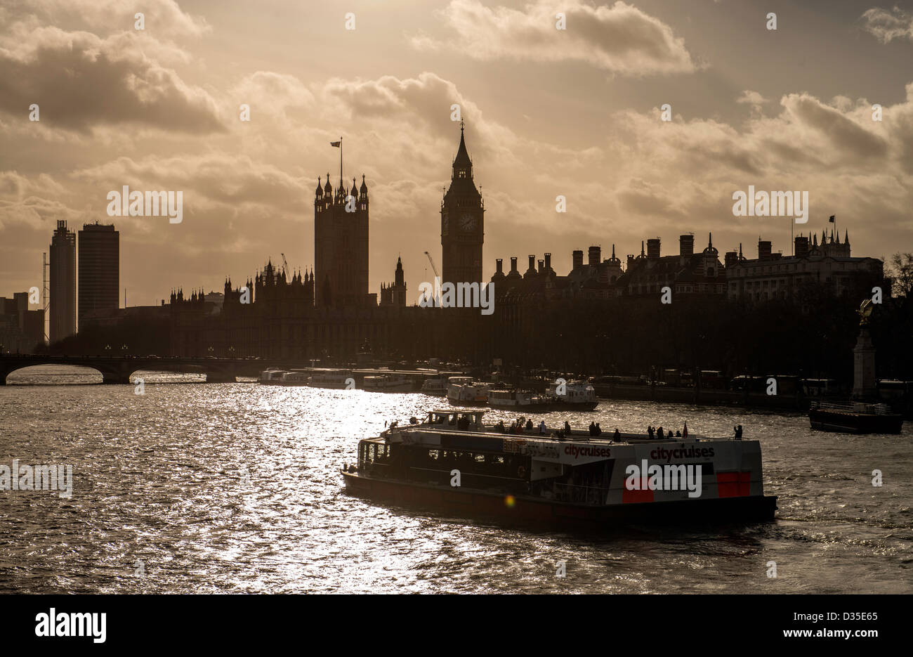 River cruise boat in the River Thames and Big Ben London England Great Britain UK - Stock Image