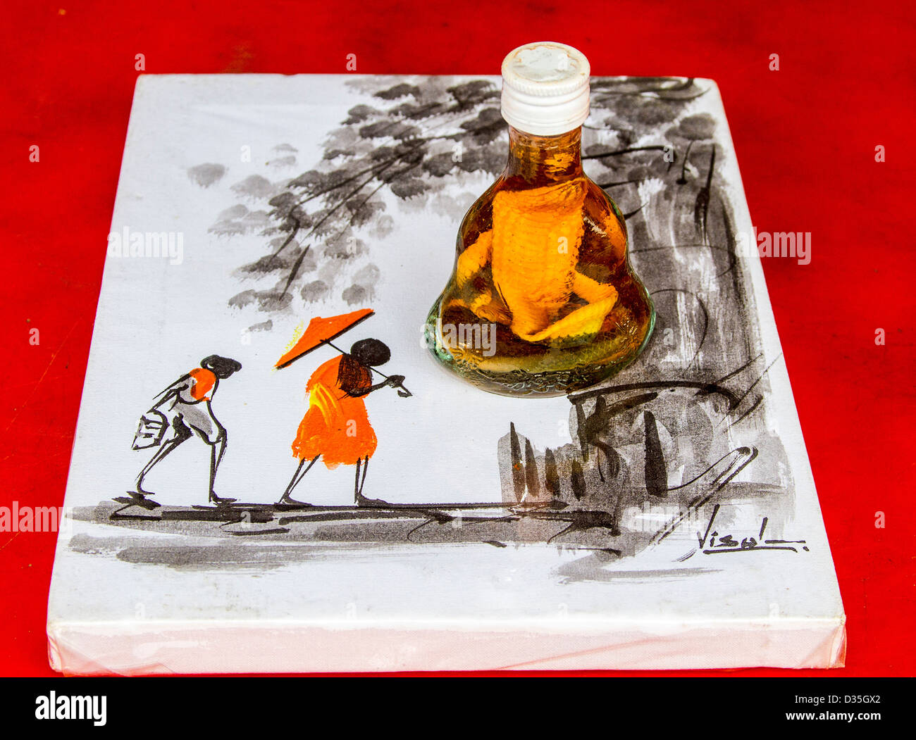 Rice wine with plastic model of cobra snake sold as a souvenir. The real thing is sold to 'cure' coughing - Stock Image