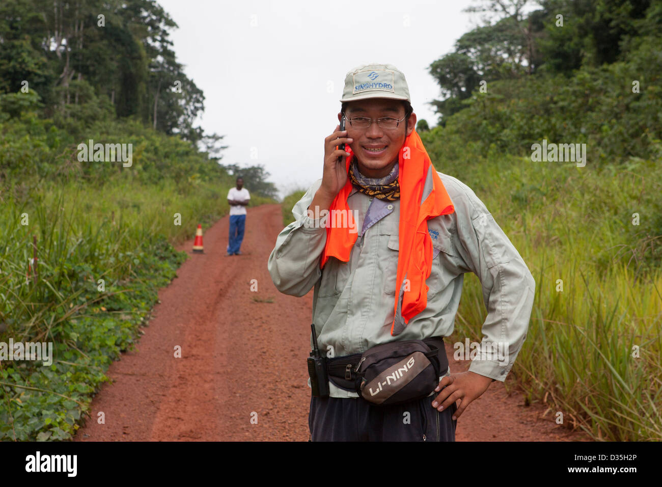 CONGO, 27th Sept 2012: Chinese road engineer from company Sinohydro supervising the building of a major new tarmac - Stock Image
