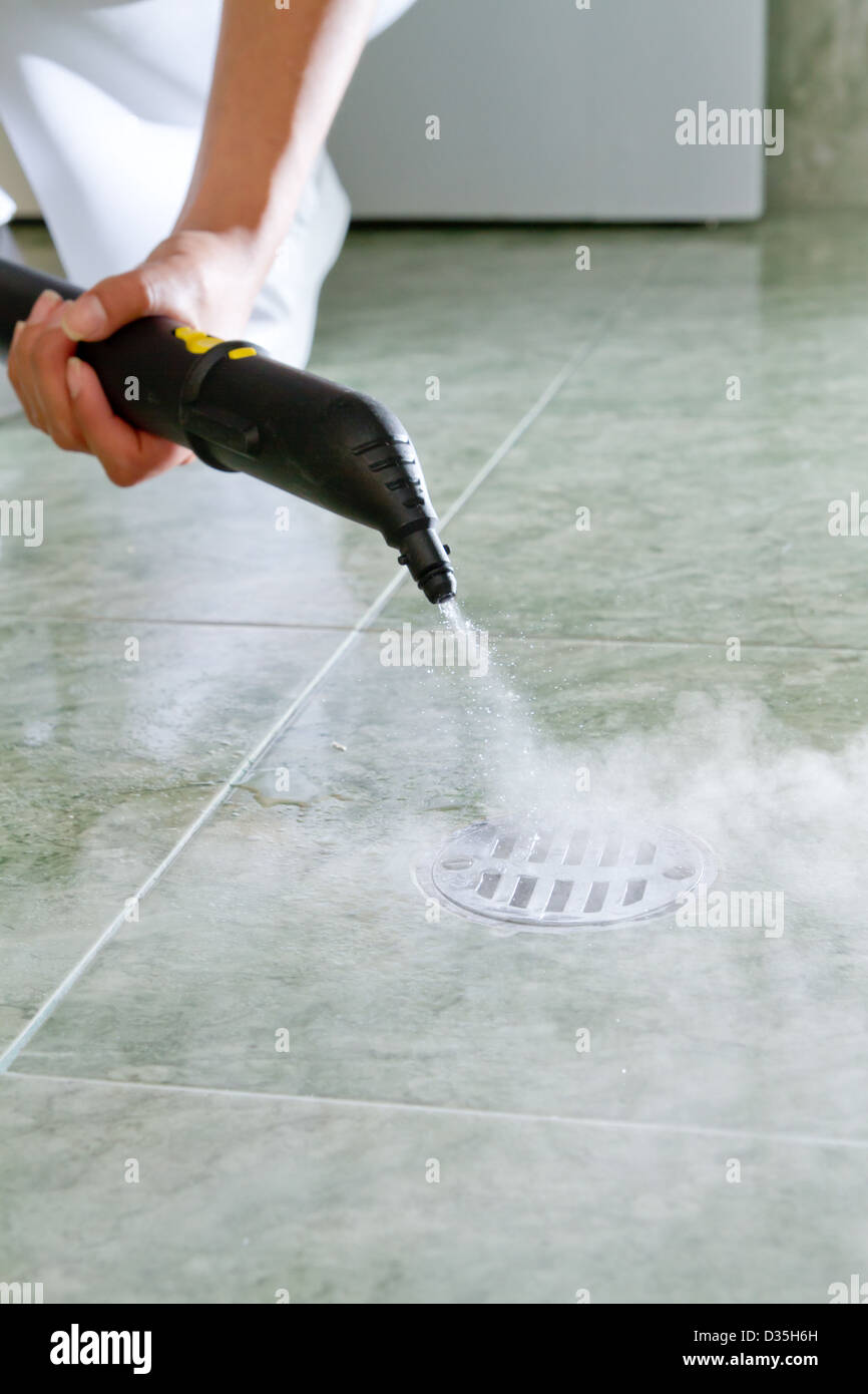 Woman cleaning drain in bathroom with steam Stock Photo: 53598345 ...