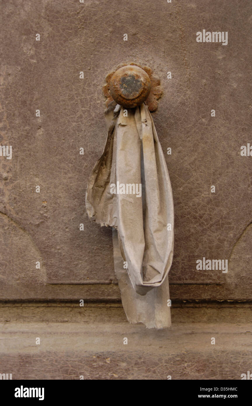 Door knob with hanging cloth. Oulx, Italy. ©mak - Stock Image