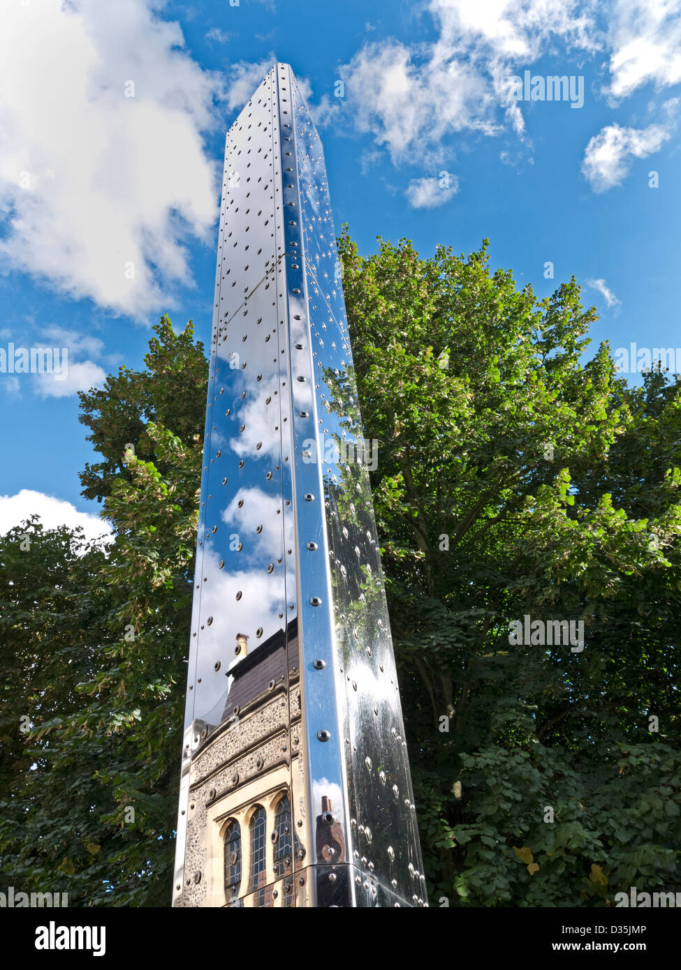 Peter Freeman's metal tower of light 'Luminous Motion' a contemporary public art sculpture at Winchester - Stock Image