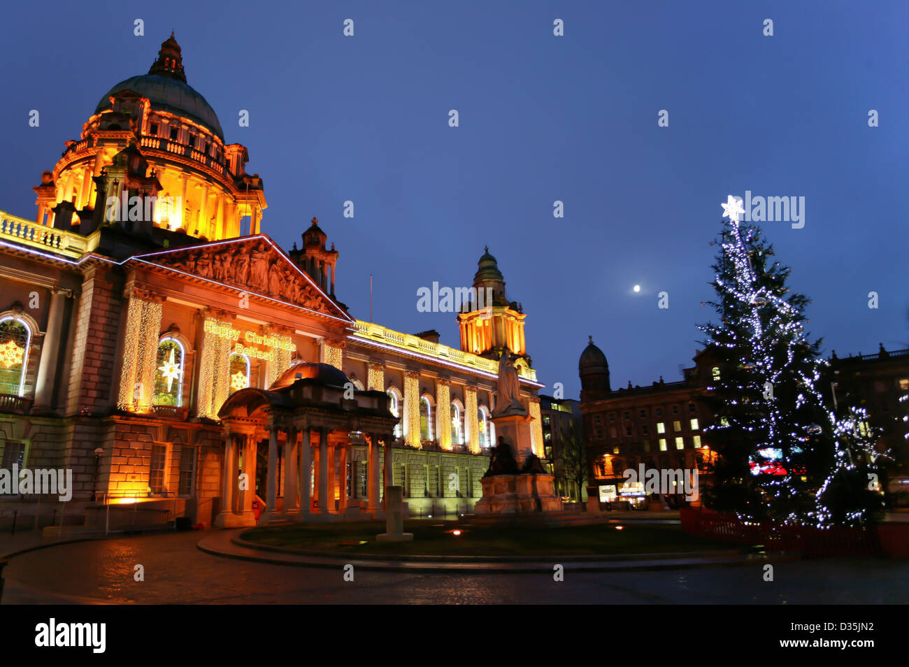 2nd January 2012, Belfast City Hall adorned with Christmas decorations,moon rise, Decorations - Stock Image