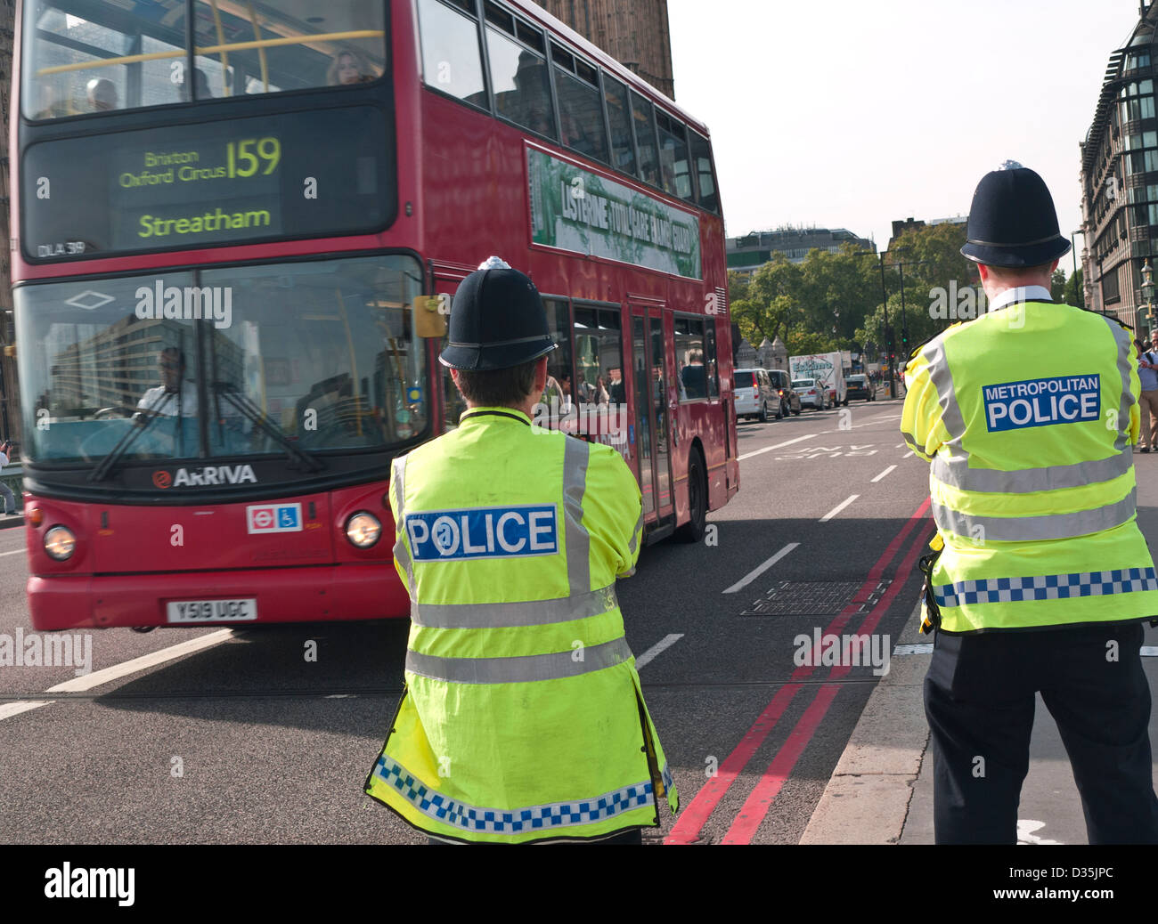 Metropolitan Police officers on duty at Westminster Bridge red route  Houses of Parliament London UK - Stock Image