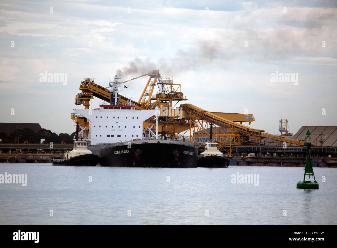 The  Panamax  MV Double Rejoice Dry Bulk Carrier fully loaded with export coal departing Newcastle Australia - Stock Image