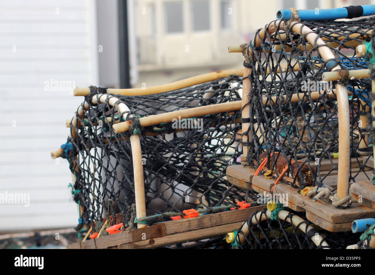 Lobster pots and creels with building in background and copy space. - Stock Image